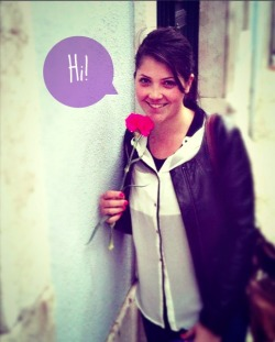 Vanessa Fernandes holding flower saying hi.