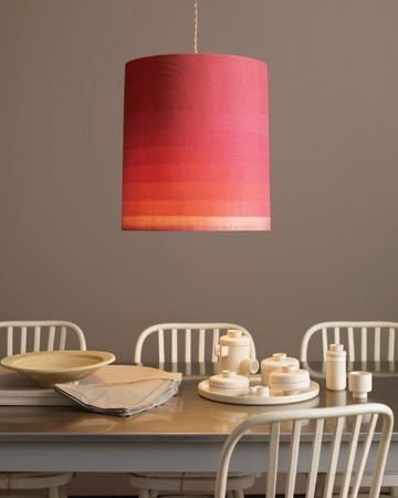 Graduated Pink Ombre Pendant Lampshade over neutral white table setting